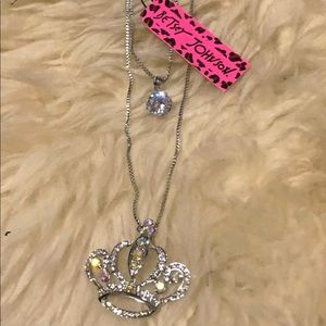 Betsey Johnson long silver layered necklace.